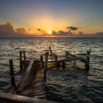 an old dock in caye caulker belieze at sunrise