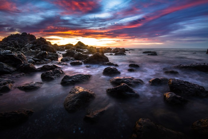 Sunrises over a rocky shoreline on the Pacific Coast of Costa Rica