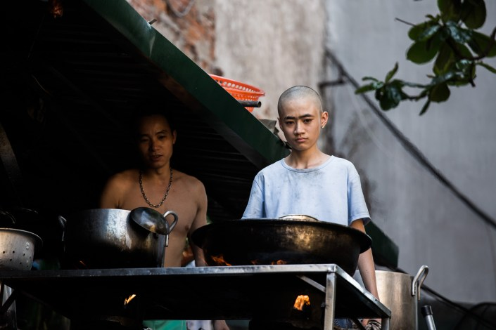 portraits of cooks preparing meals in an outdoor kitchen in vietnam