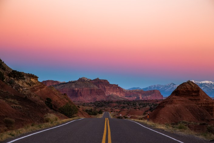 road leads down into valley of fire state park at sunset