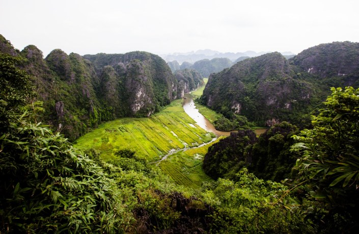 looking down on the rivers that flow between granite cliffs and rice paddies