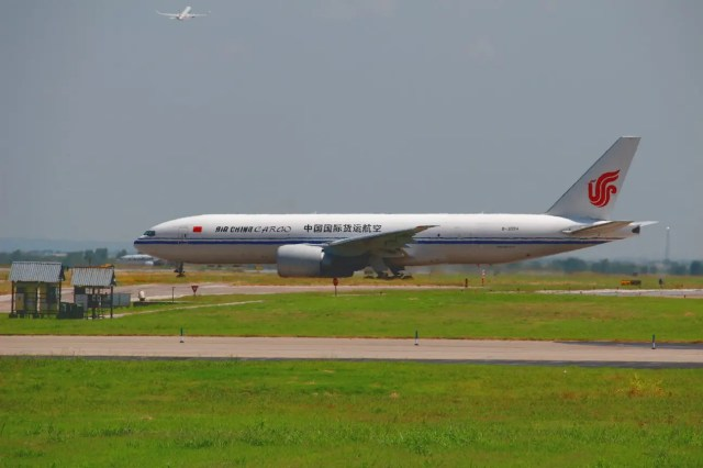 The Air China Cargo 767 waiting for clearance to cross the runway.