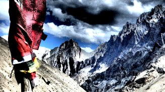 CATHEDRAL OF HEAVEN | Prayer flags wrap around a pole in a dramatic Himalayan backdrop | Ladakh