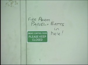 """Writing on the utility room door: """"FIRE ALARM PANEL + BATTS in here!"""""""