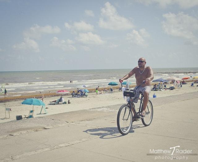 Man Riding Bike on Beach on Galveston Island (13)