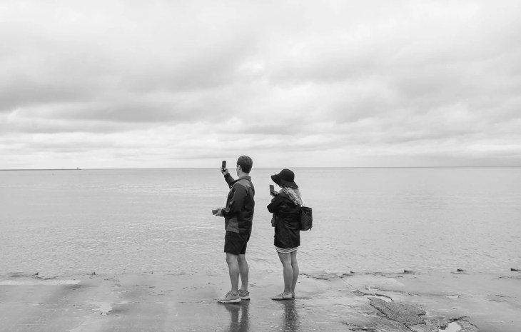 A couple taking a selfie at Chicago Beach
