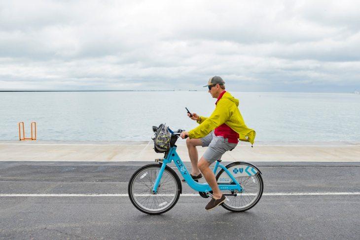 A texting cyclist at Chicago Beach