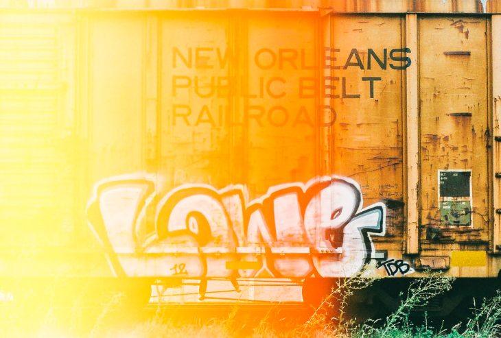 Light leak in a photo of graffiti on an abandoned rail car