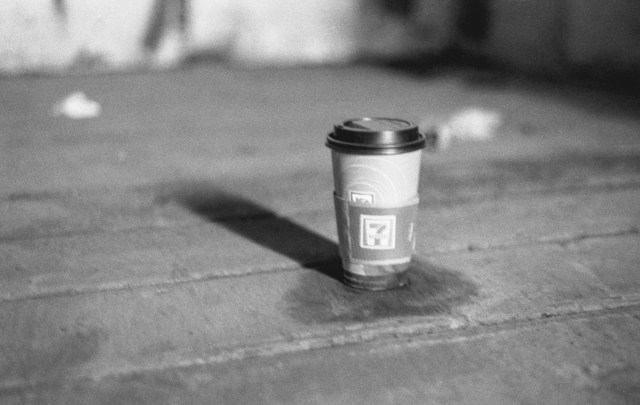 A 7-11 Coffee cup in an abandoned boxcars