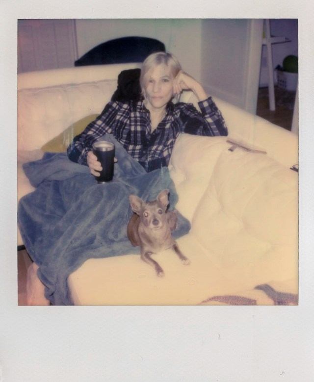 My mom with pebbles hanging out with us Polaroid photos