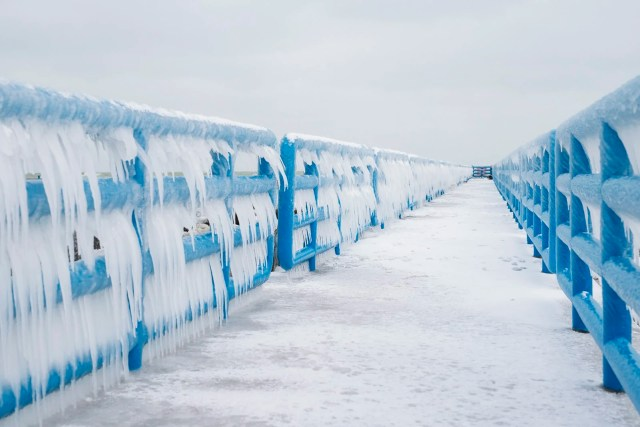 Frozen rails at Holland State Park Beach