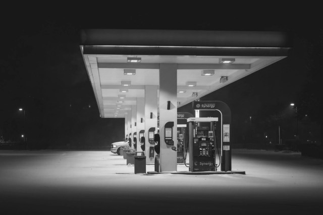 75 and Lesson 7-11 gas station at night