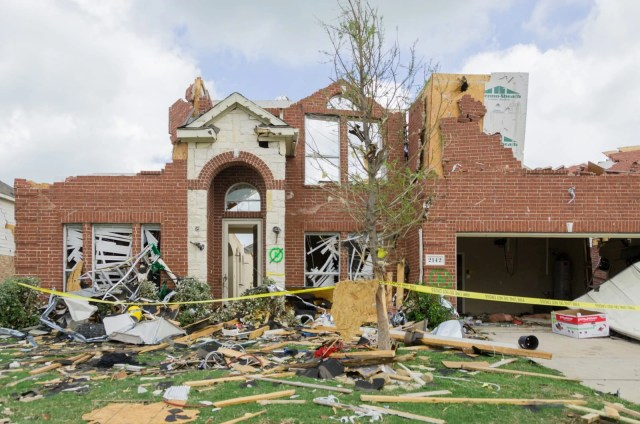 A facade of a house still standing after the tornado