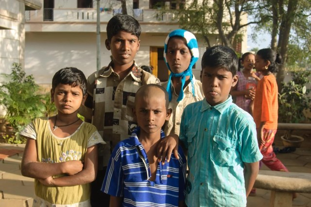 The Indian girl with a few of her adopted brothers