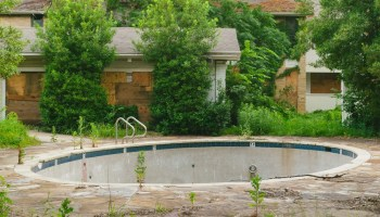 An empty pool at an abandoned apartment complex in Dallas