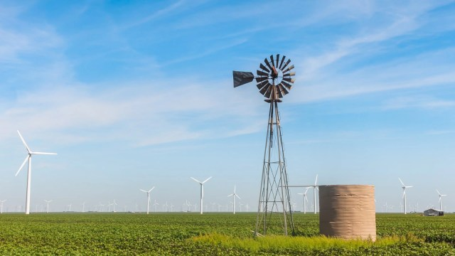 Old windmill with wind turbines