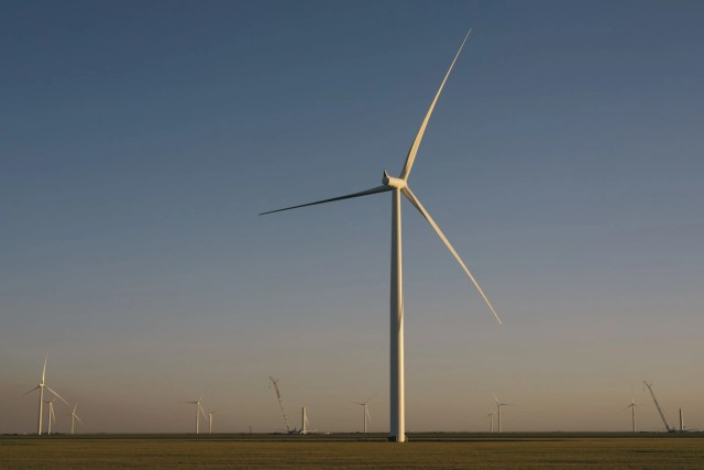 Wind turbines at the nearby wind farm in Adrian, Texas