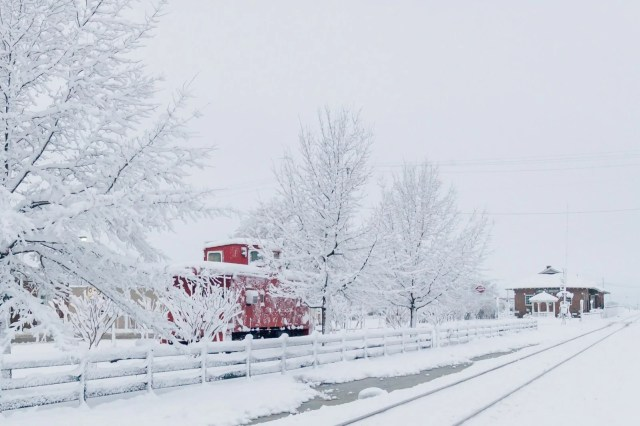 Red train caboose in Wills Point snow