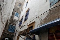 looking at the architecture and peeling white walls