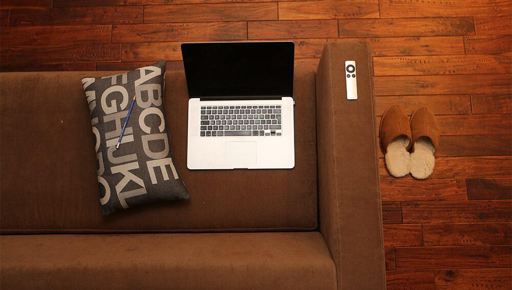 Laptop sitting on a sofa
