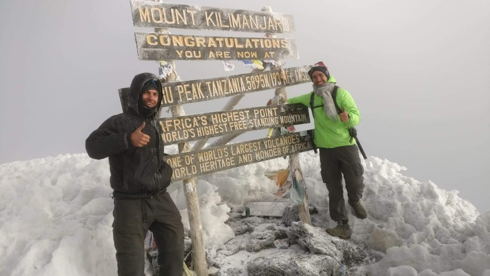 Lukas and I at the top of Mount Kilimanjaro - Uhuru Peak, 5895M above sea level