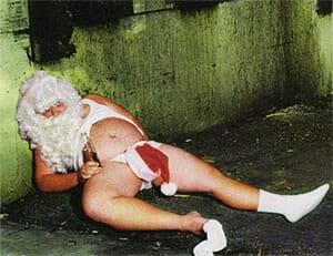 Santa Claus drunk in the gutter