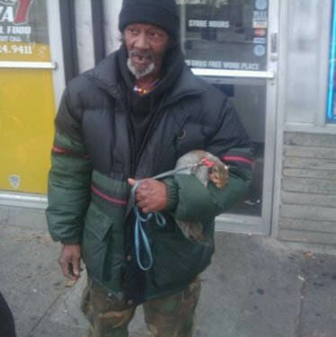 homeless guy with squirrel on a leash