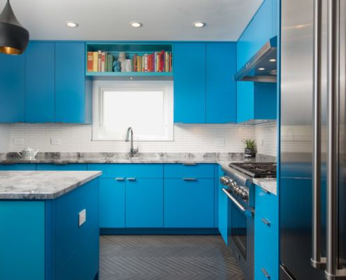 Architectural photograph of kitchen remodel with blue cabinets.