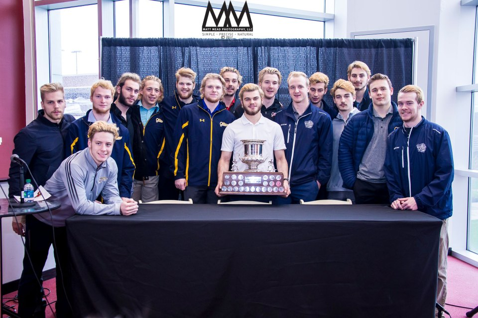 Erie Otters Hockey Club with Tilson trophy