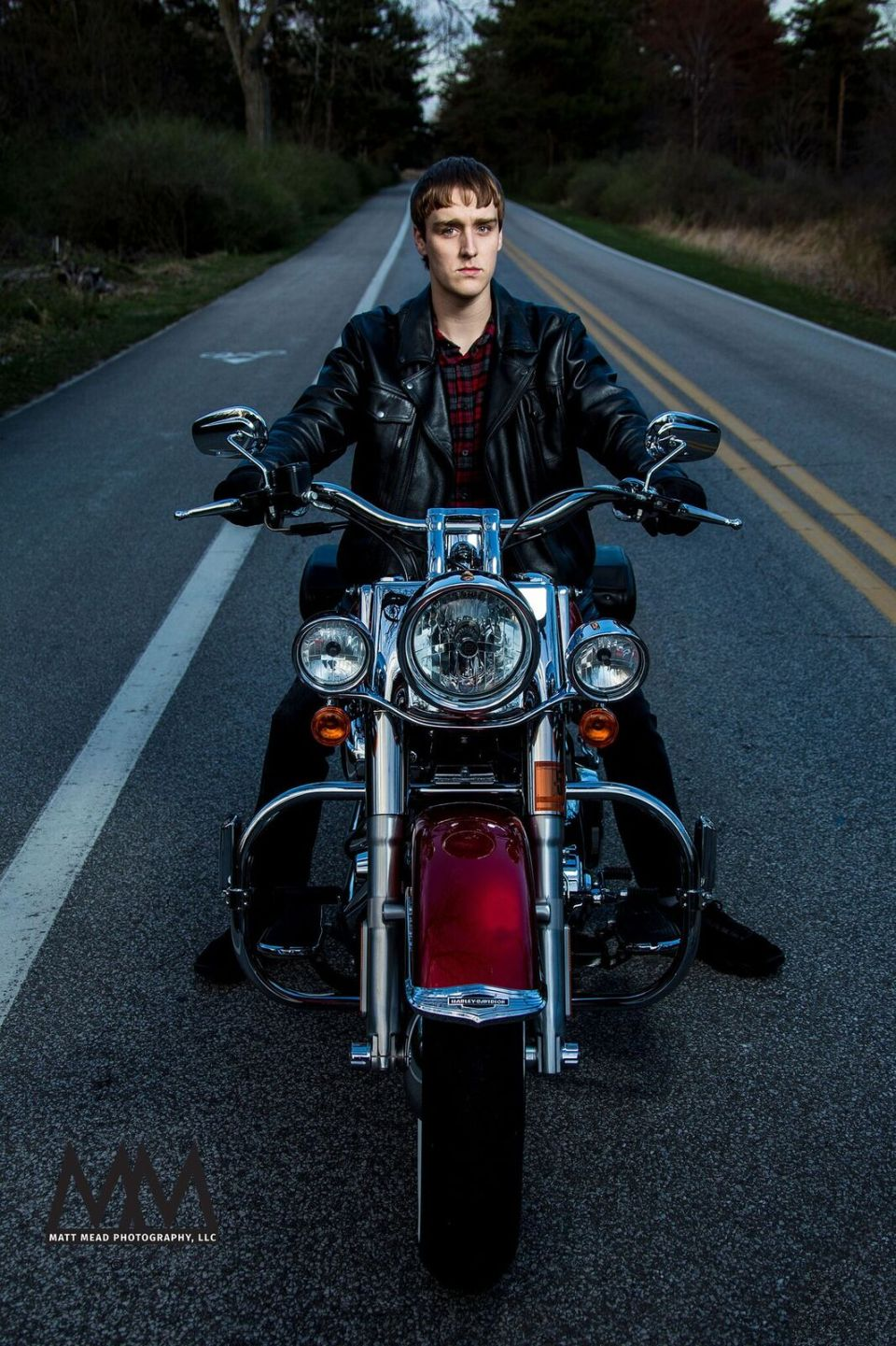 Teen riding a motorcycle at Erie PA senior portrait session