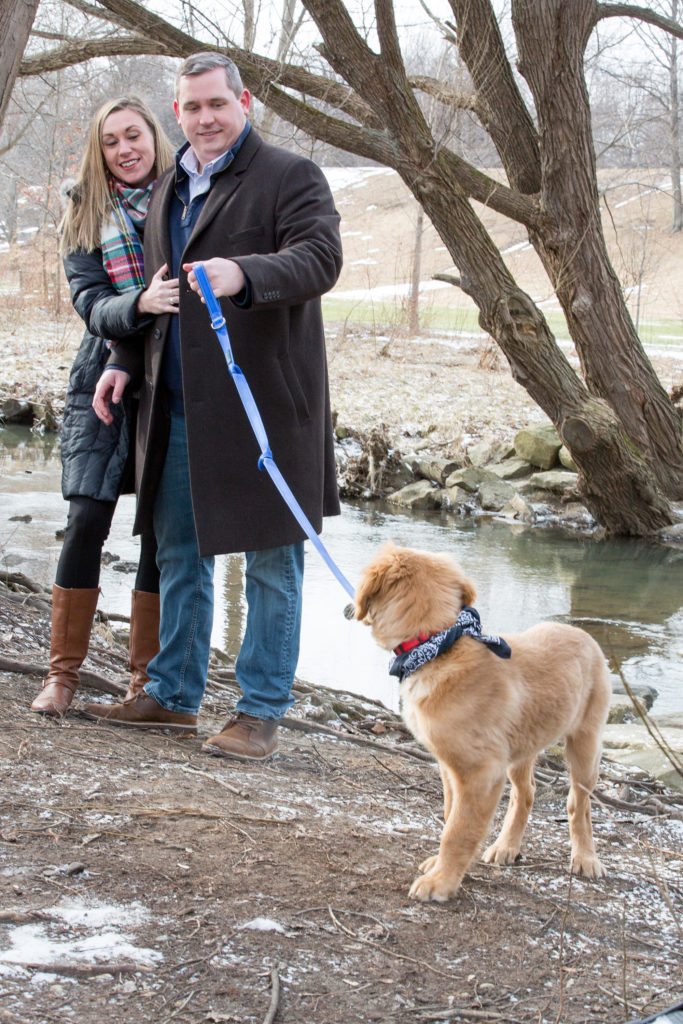 couple walking their Golden Retriever puppy at Frontier Park in Erie, PA