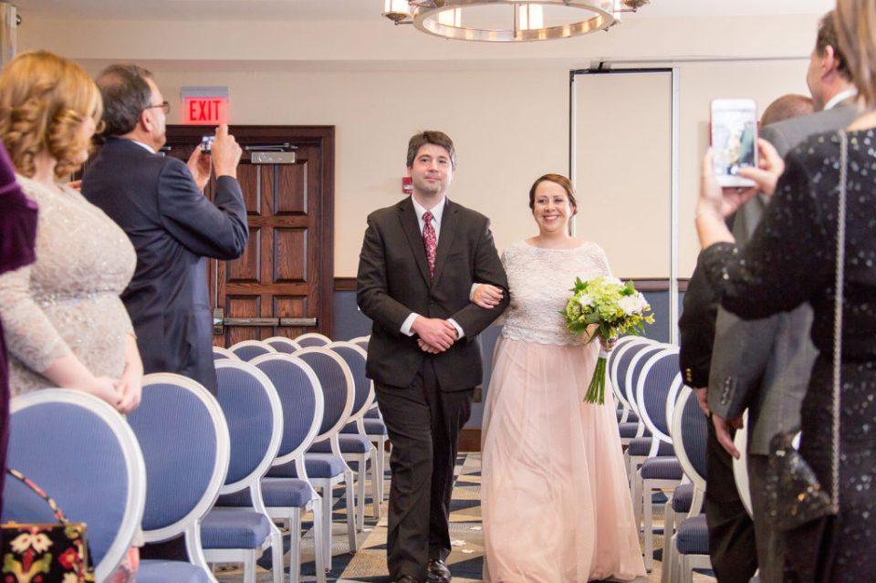 Erie, PA bride walking down the aisle at Sheraton Bayfront hotel wedding