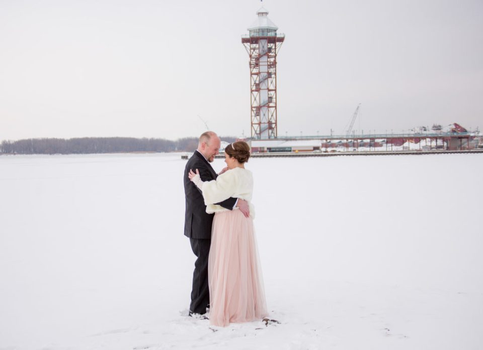 bride and groom dancing in front of Bicentennial Tower in Erie, PA