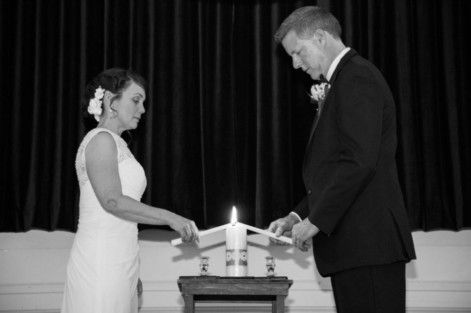lighting the unity candle at Masonic Temple wedding ceremony in Erie, PA