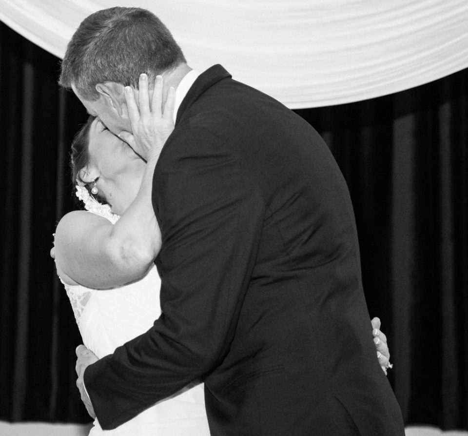 bride and groom kissing at Masonic Temple wedding ceremony in Erie, PA