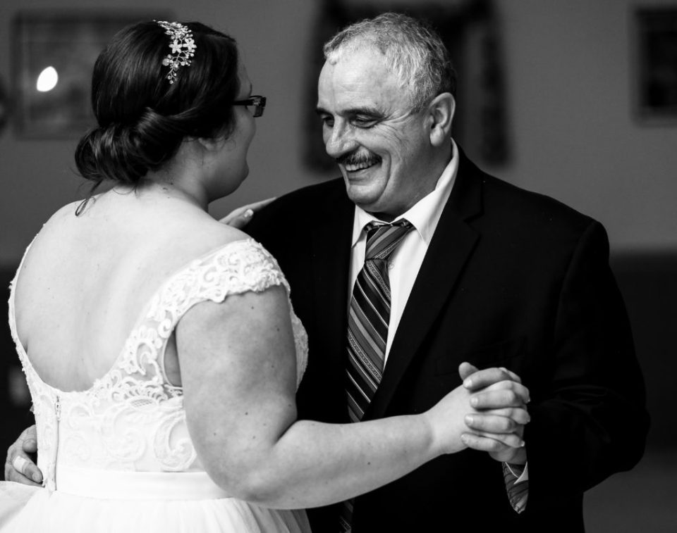 bride dancing with her father during her winter wedding in Erie, PA