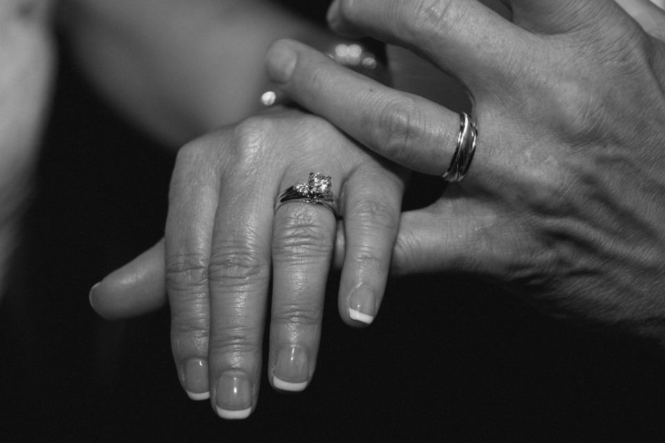 close-up of bride and groom holding hands at Erie, PA Masonic Temple wedding