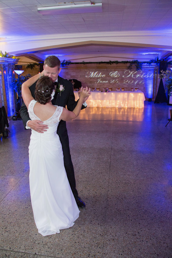 bride and groom dancing at their Masonic Temple wedding in Erie, PA