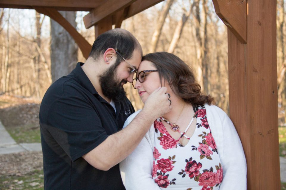 engaged couple touch foreheads at Robin Hill Park engagement session