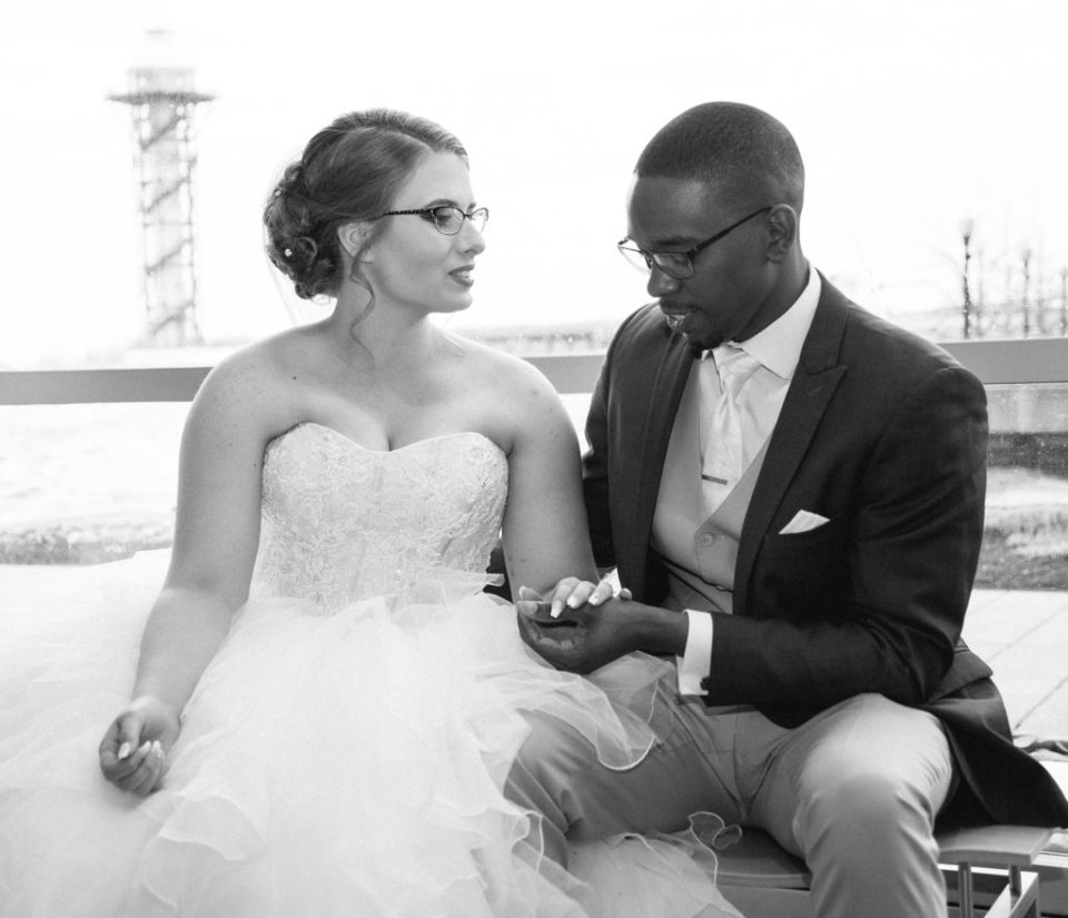 bride and groom hold hands during first look before wedding at Sheraton Bayfront Hotel Erie, PA