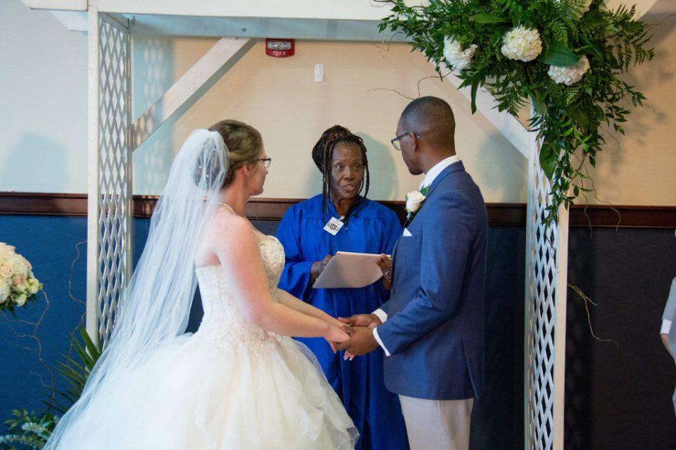 couple exchanging wedding vows at Sheraton Bayfront Hotel Erie, PA