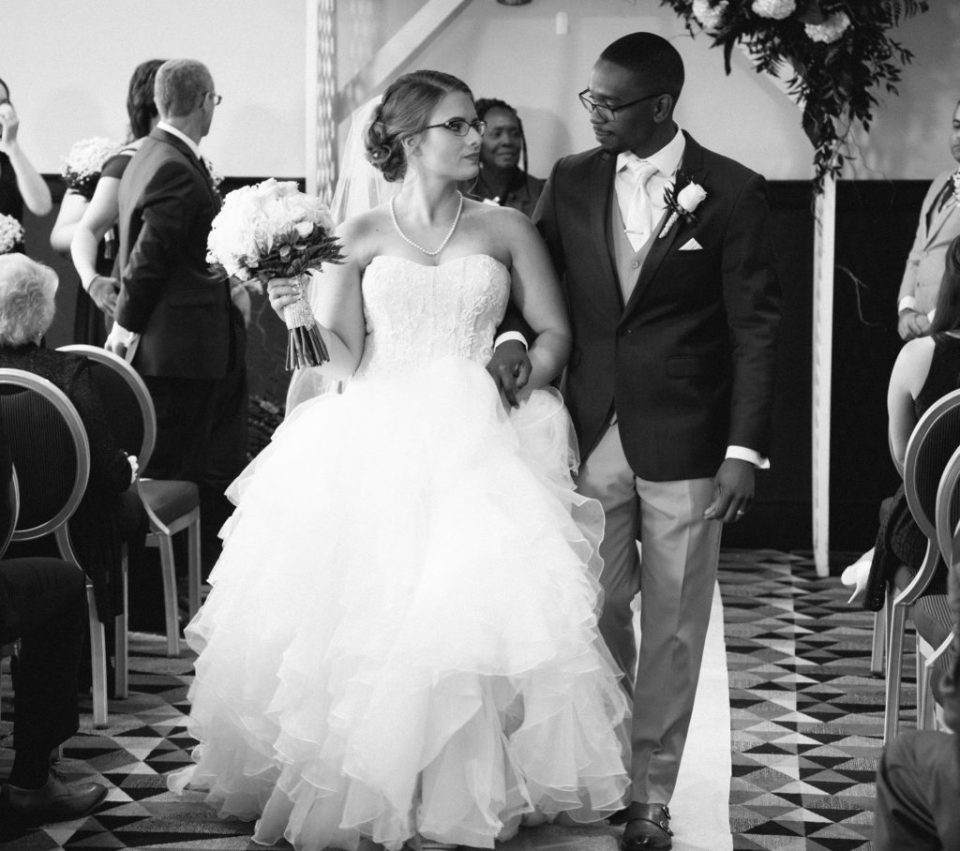 bride and groom during recessional after their wedding at Sheraton Bayfront Hotel Erie, PA