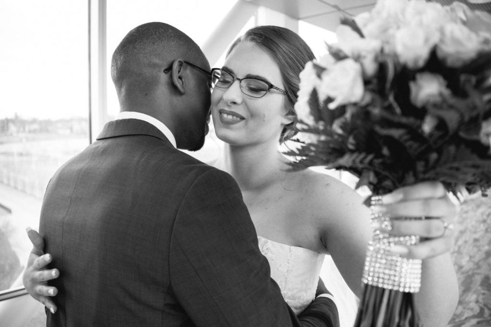 bride and groom embrace during first look photos at Sheraton Bayfront Hotel Erie, PA