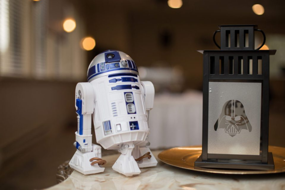 R2-D2 figurine and Darth Vader lantern at Star Wars themed wedding