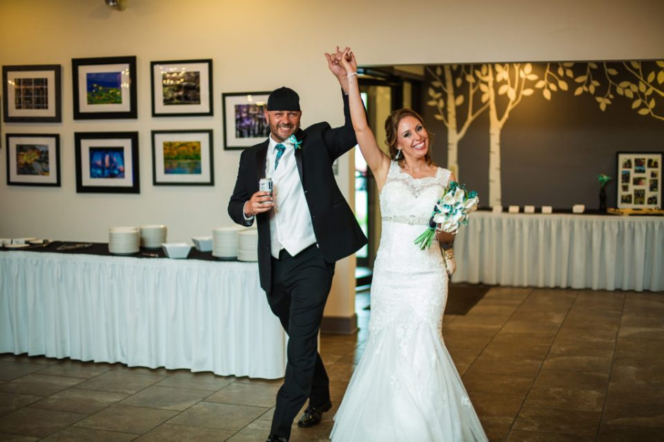 bride and groom enter reception hall at Erie PA wedding