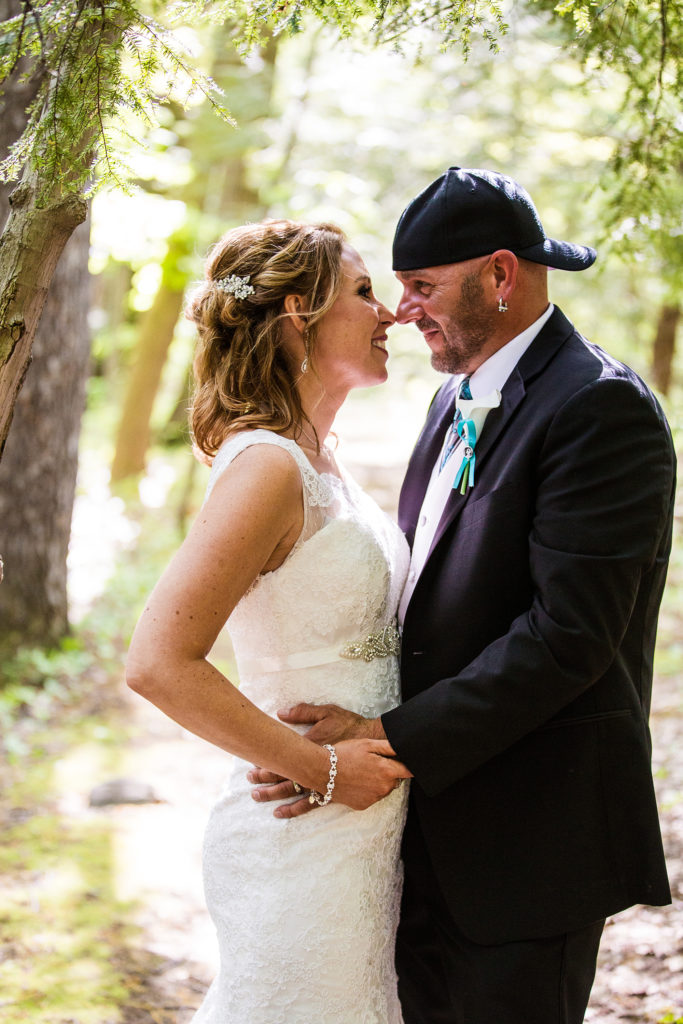 bride and groom embrace during portraits at their Erie PA wedding