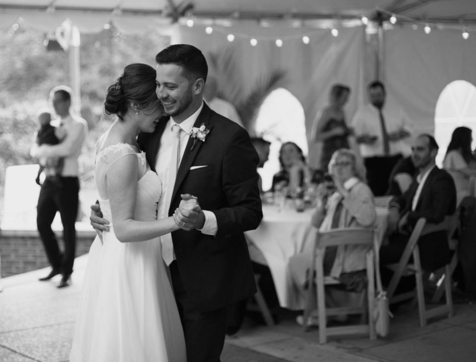 couple shares first dance at their Pittsburgh National Aviary wedding reception