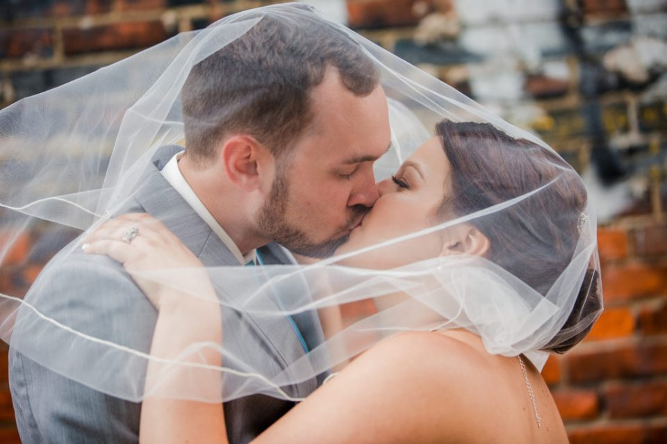 bride and groom kiss under her veil at Brewerie wedding in Erie PA