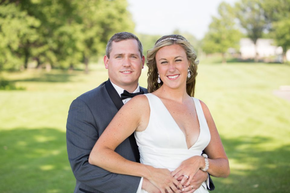 Erie PA couple poses at Lawrence Park Golf Club on their wedding day