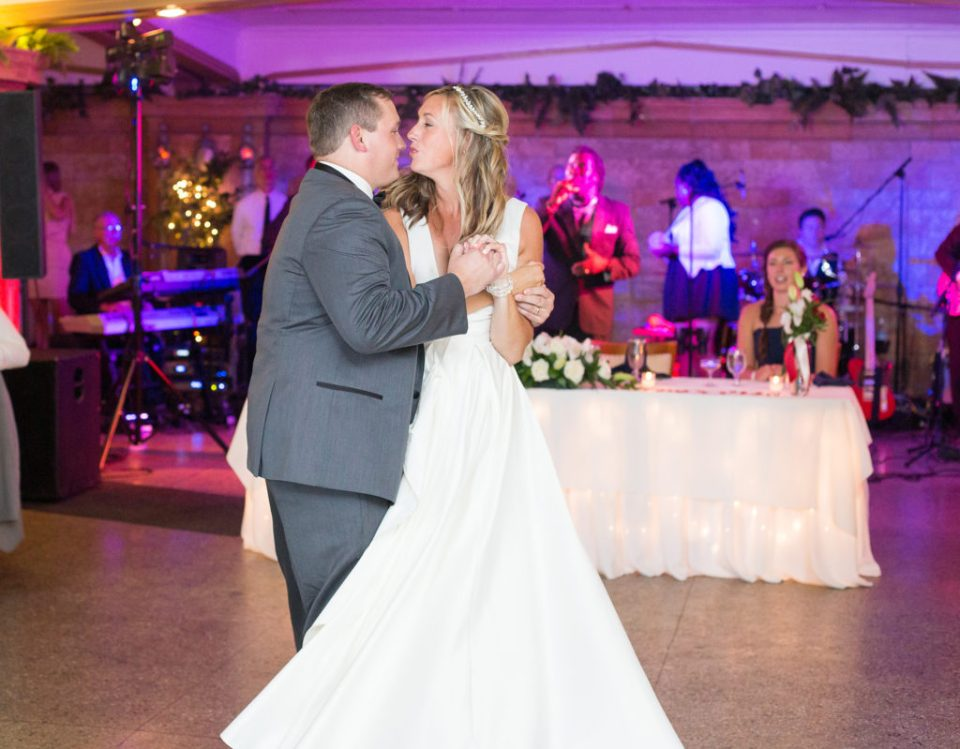 bride and groom share first dance during Masonic Temple wedding reception in Erie PA